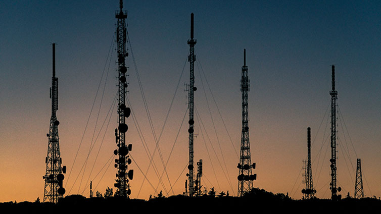 telecommunication poles on the background of sunset